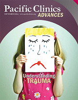 "Cover of Advances Magazine. Fall 2014. Child holding up a drawing of a crying face in front of their own. Titled ""Understanding Trauma."""