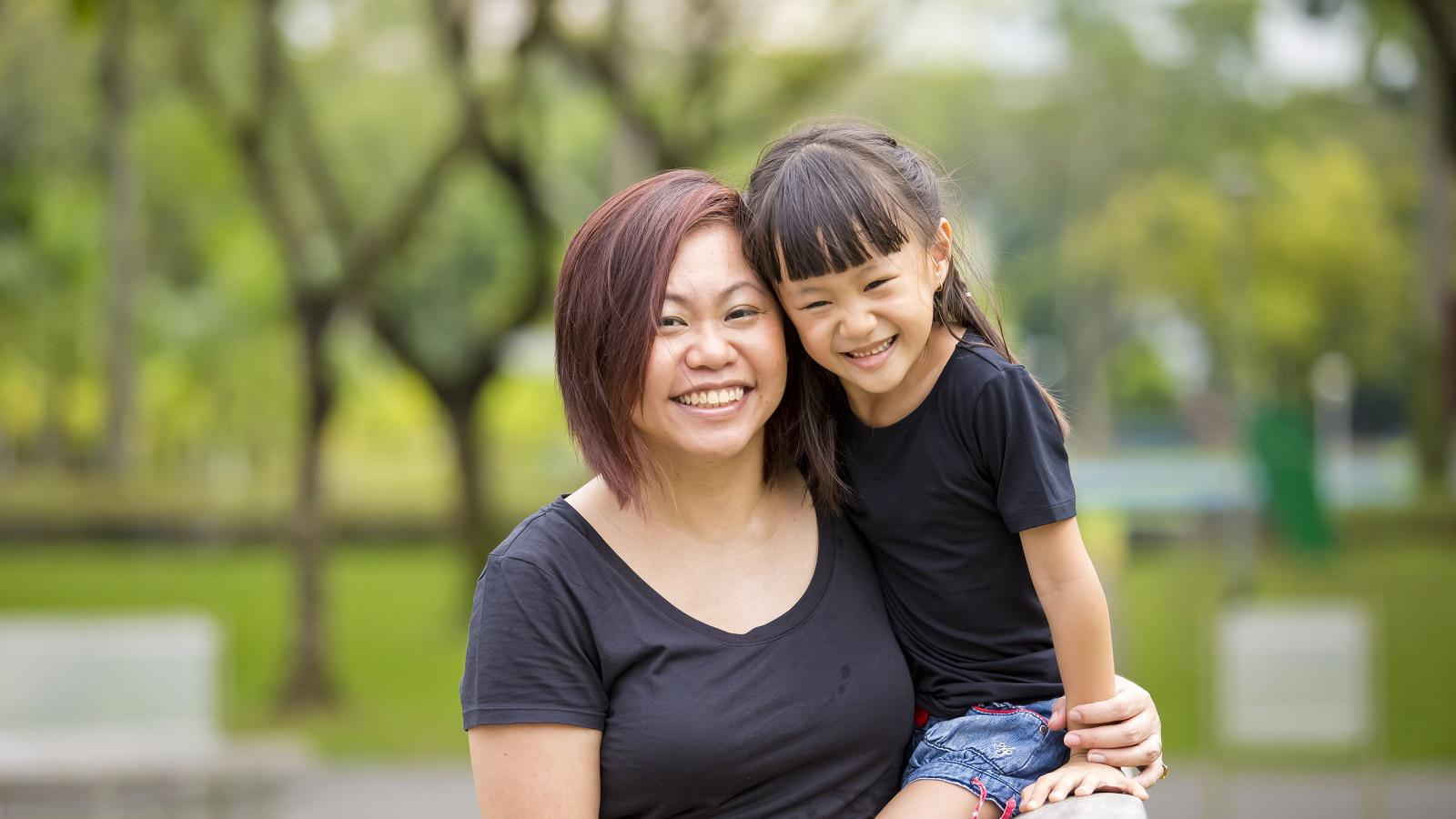 """A mother hugging her daughter. Both are smiling. Text reads, """"Our life-changing services empower clients."""""""