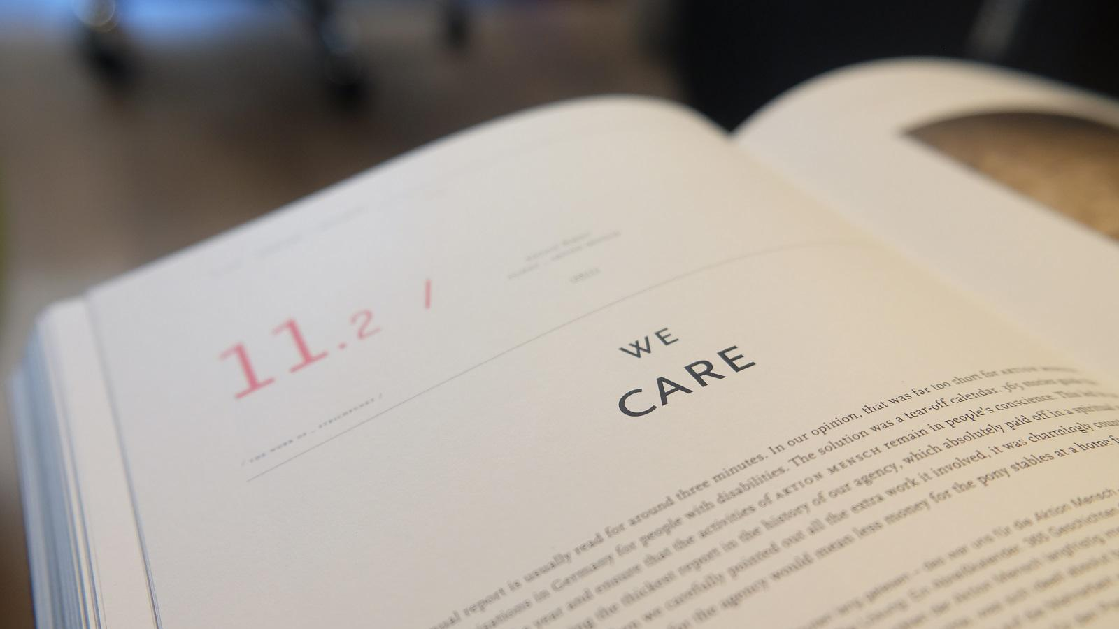 "A close up image of a book with a chapter title of We Care. Text reads, ""1 in 5 adults in America experience a mental illness in a given year."""