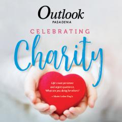 """Hands holding a heart displaying a Martin Luther King Jr. quote, """"Life's most persistent and urgent question is 'What are you doing for others?'"""""""